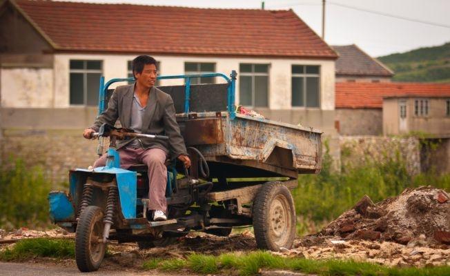 Farmer on the road beside the school