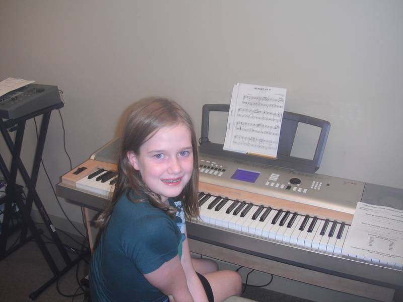 Miss Erin at the keys learning her Minuets in C & ...instructor - Shelia Christofalos