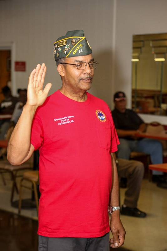 Cdr Sherwood Brown take the Oath of Office