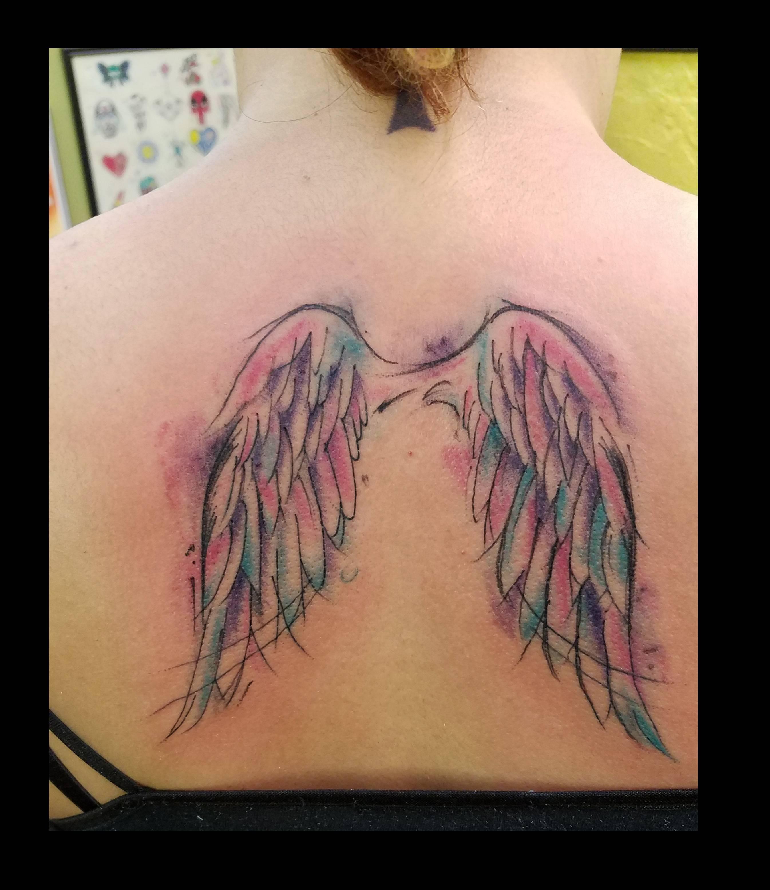 Watercolor Wings tattoo by Ruben