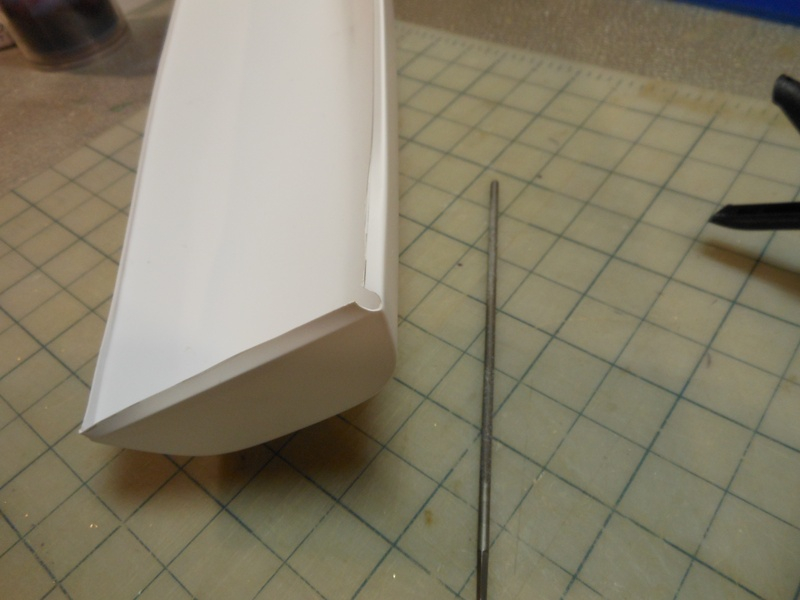 Round file into corners before folding