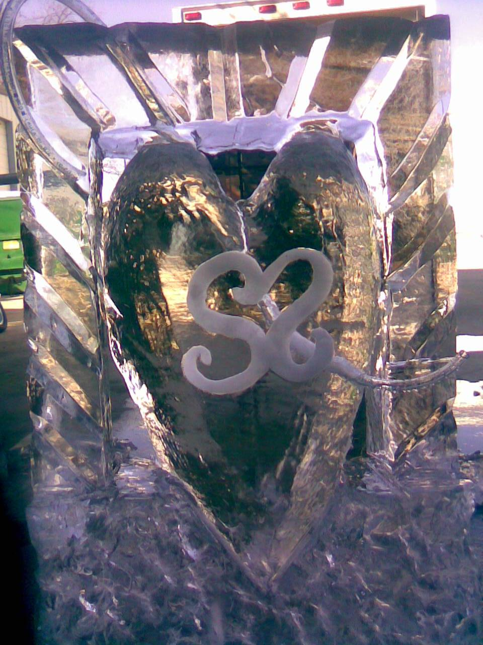 Initials on heart with luge