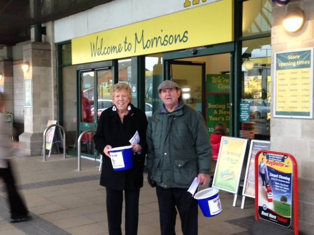 Margaret and Michael collecting outside Morrisons