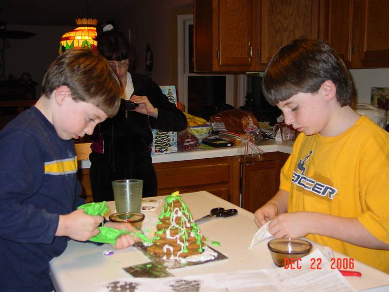 Matthew and Andrew make Christmas cookie cake