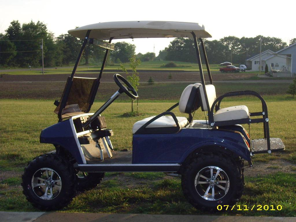 """2006 Club Car Gas with new body, 6"""" lift, tires and wheels, rear flip seat"""