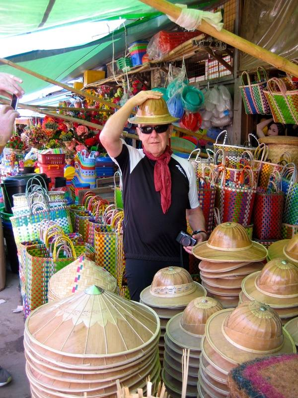 Shopping - buying the traditional Burmese hat!