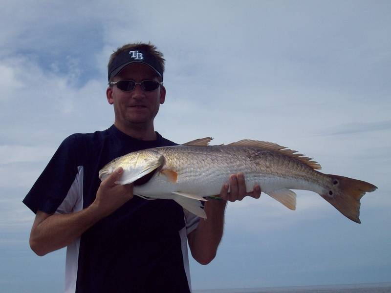 "John Krause with a 32"" redfish."