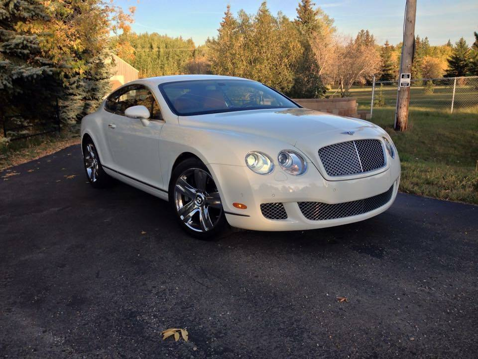 a Bentley Continental GT leaves after seasonal maintenance