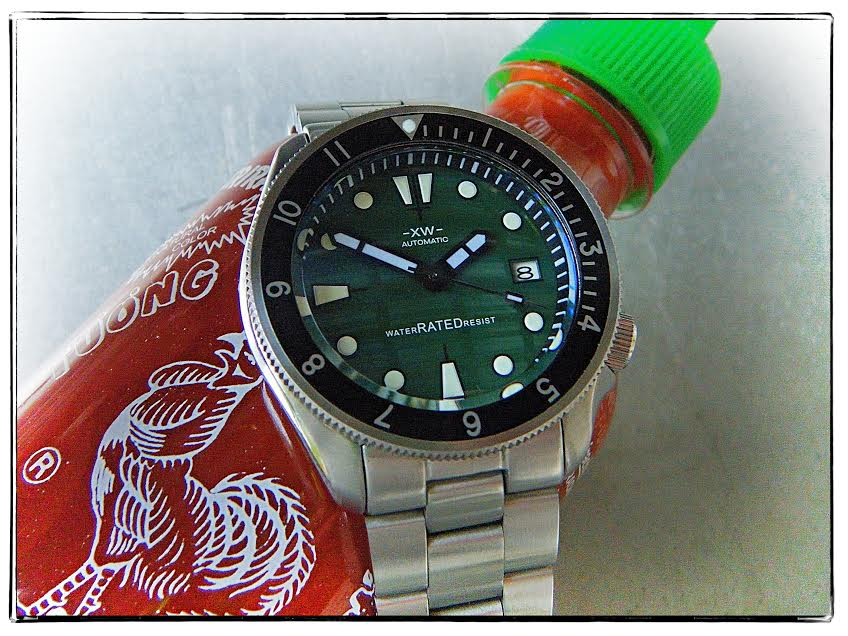 """Still life with Sriracha bottle and modded watch"""