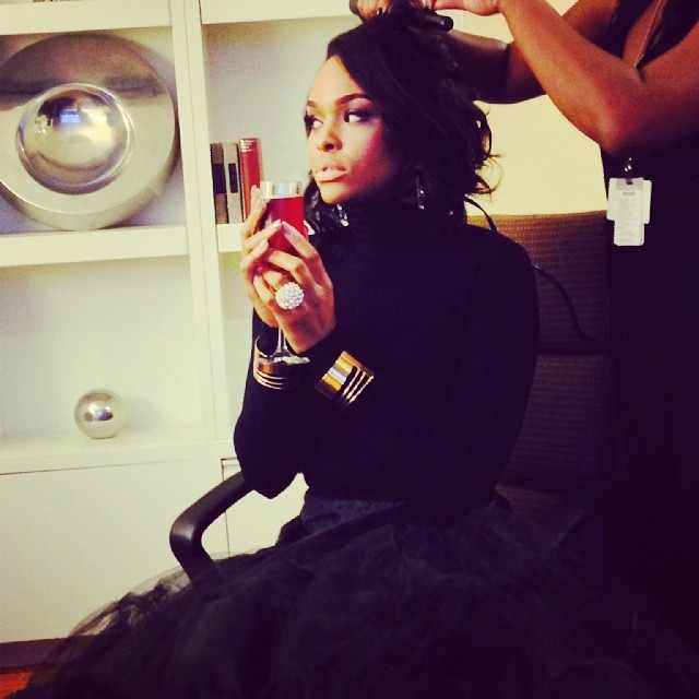 Demetria McKinney preparing for the '30th Annual Mayor's Masked Ball' on December 21, 2013