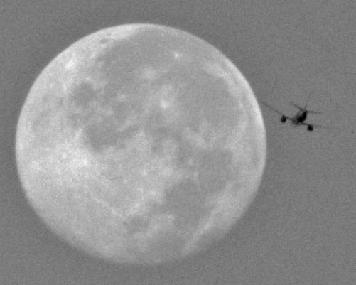 The Moon with a plane, August, 2010