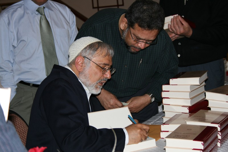 Imam Asi signs a copy of his Tafseer