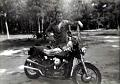 Fisher, LA 1959 with first motorcycle. Note: Winchester in bedroll.
