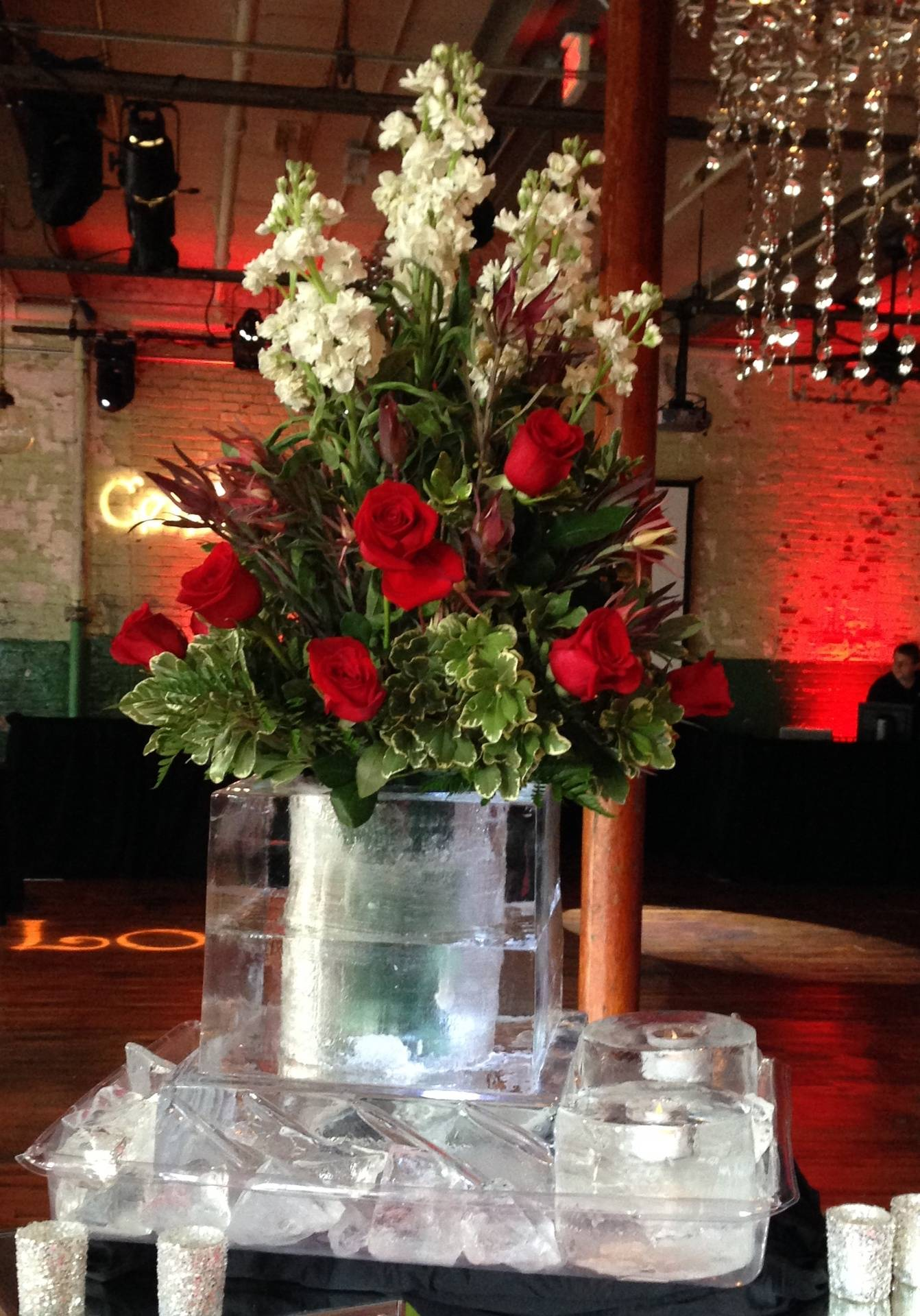 Flower display with real candle holder made of ice