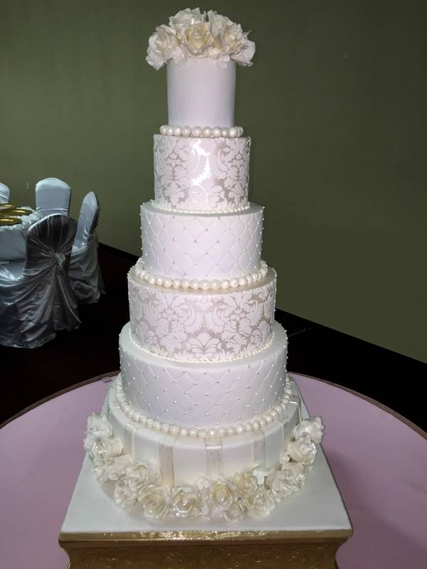 A 6 tiered wedding cake with all hand made gumpaste roses