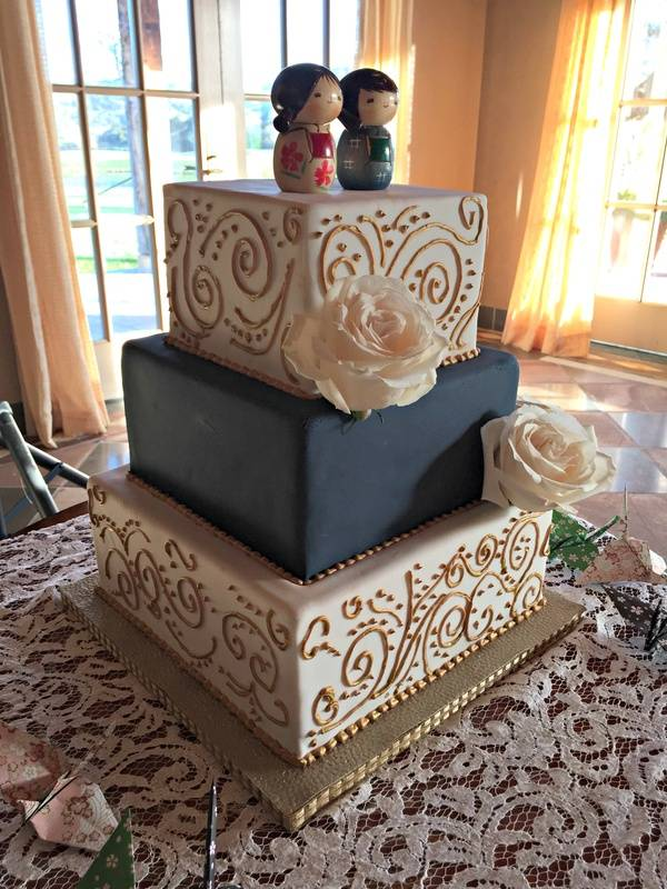 Square navy and gold wedding cake