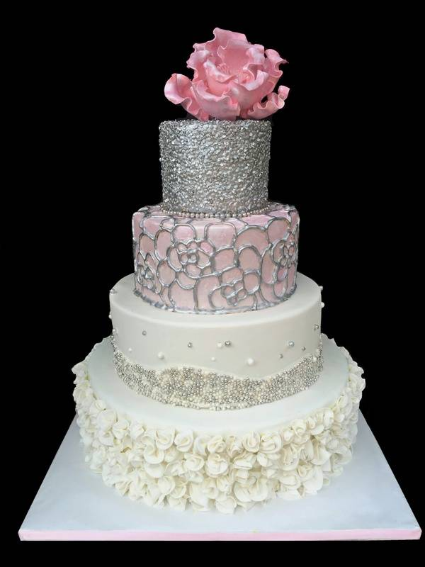 with silver edible sequins and gum paste peony