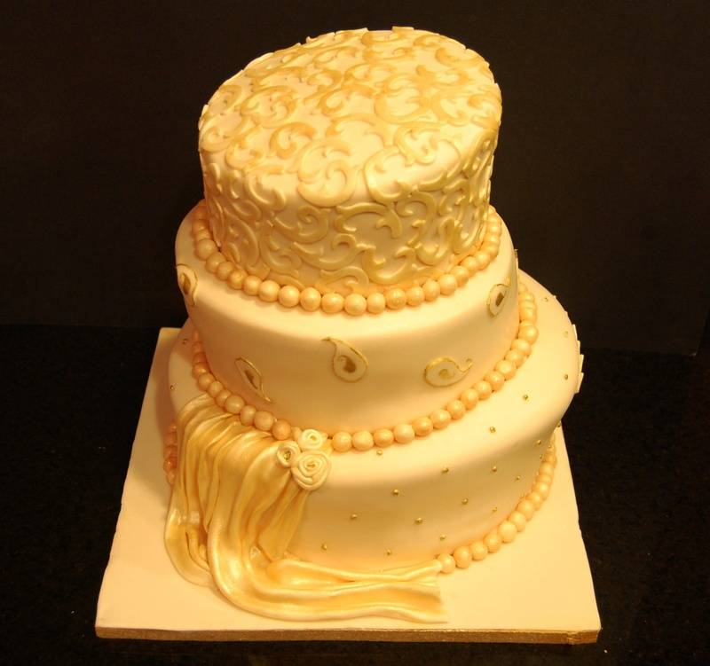 Ivory and Gold Topsy Turvy Wedding Cake