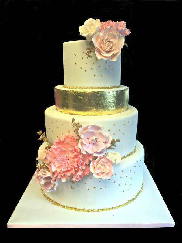 With edible gold leaf and gum paste flowers
