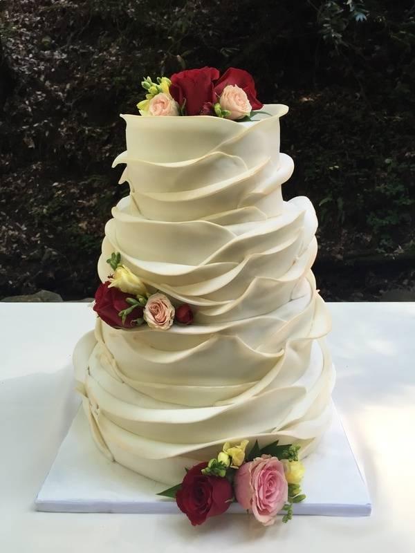 Blooming petals wedding cake