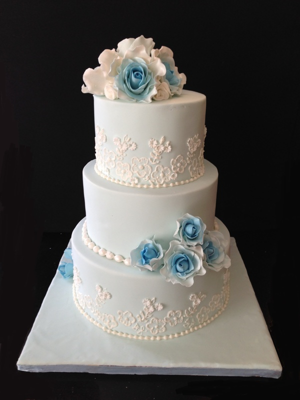 Wedding cake with brush embroidery and gumpaste roses