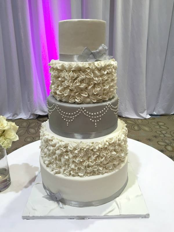 Silver and White wedding cake with fondant ruffles