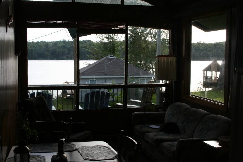 Living room looks out onto lake