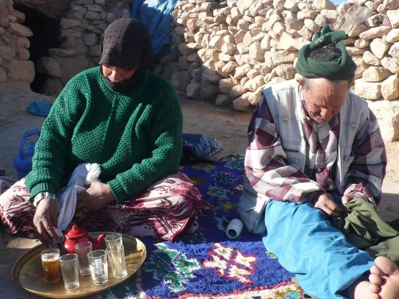 Nomad Family Serving Tea