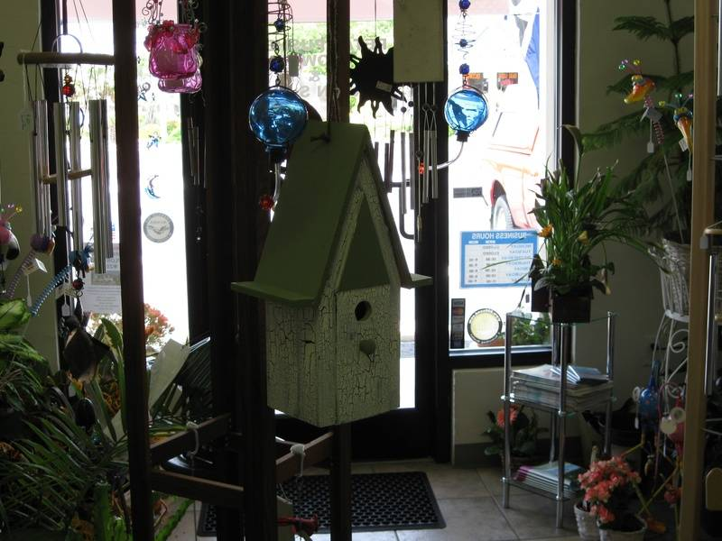 Hanging Wooden Birdhouses and Glass Hummingbird Feeders