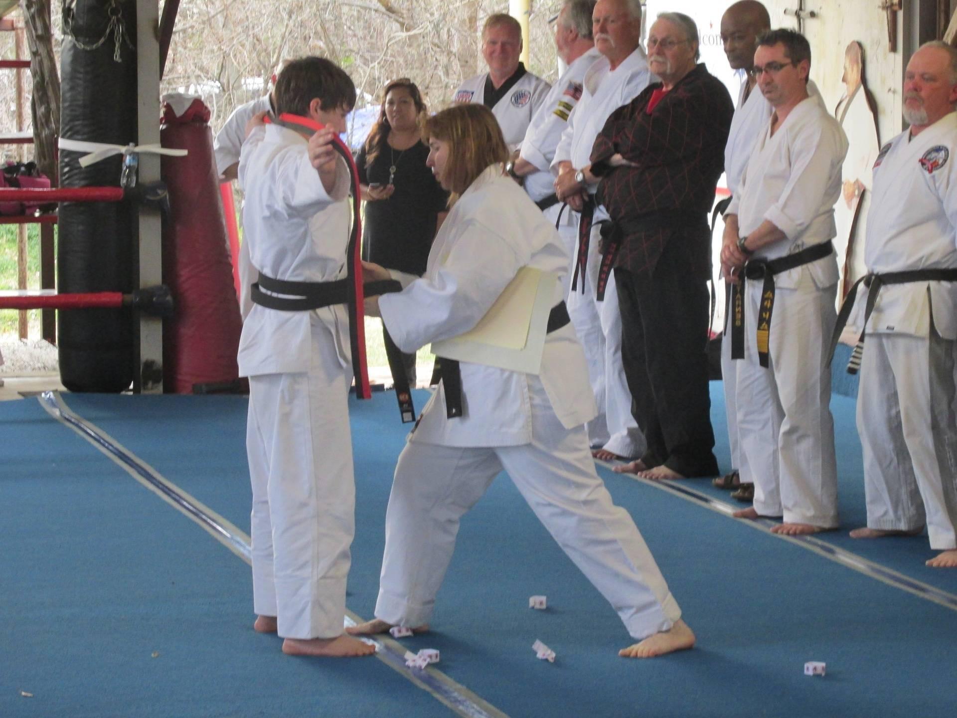 Receiving the black belt