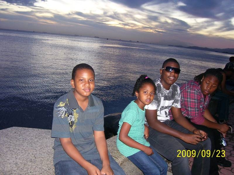 Young Sam with guests at Waterfont in Port of Spain