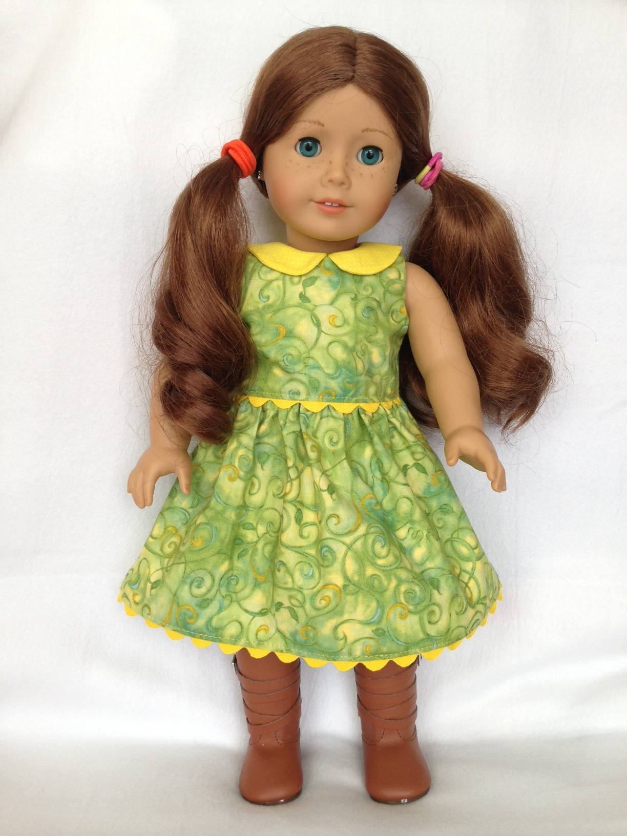 Green and yellow doll dress