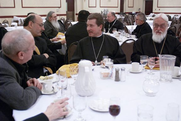 Fr. Lev Kopistiansky and the metropolitan at dinner