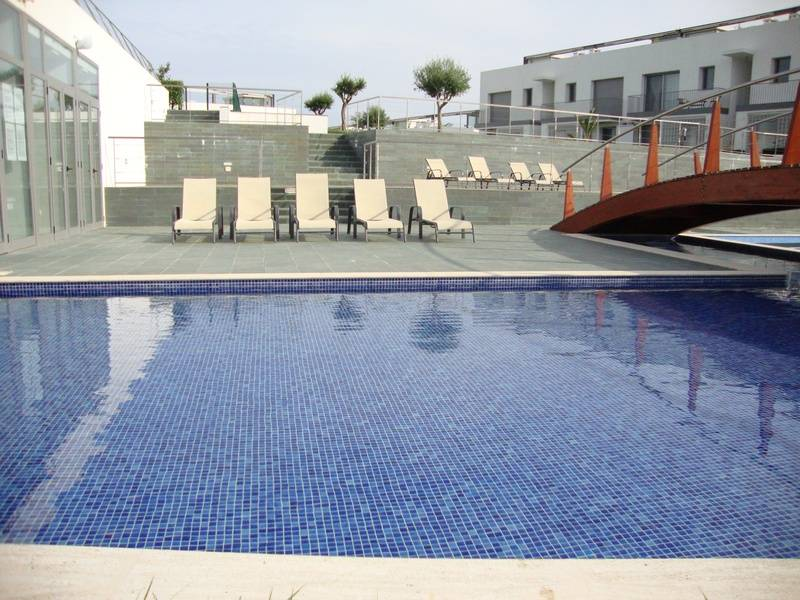 Loungers next to shallow pool