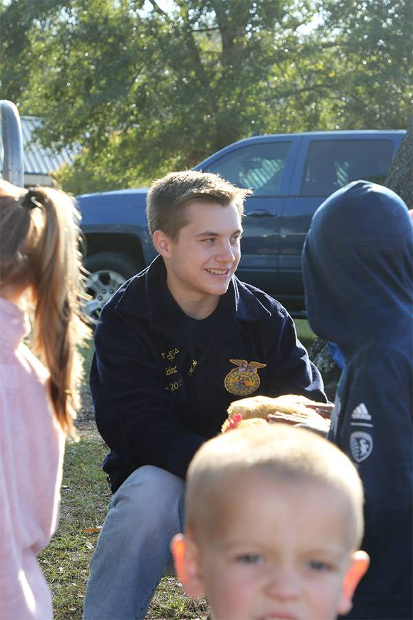 FFA volunteer with students