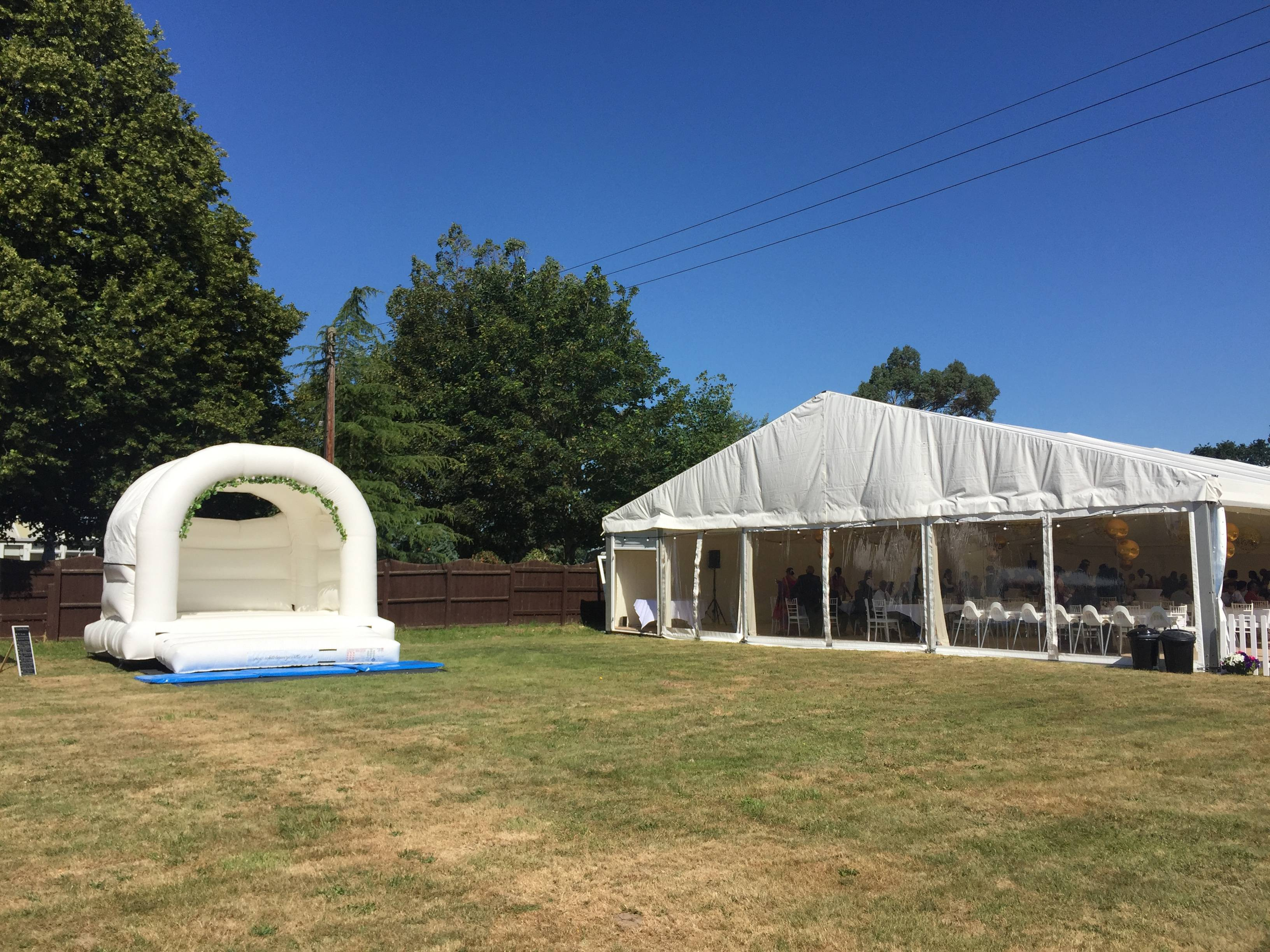 15x15ft white bouncy castle with flower arch