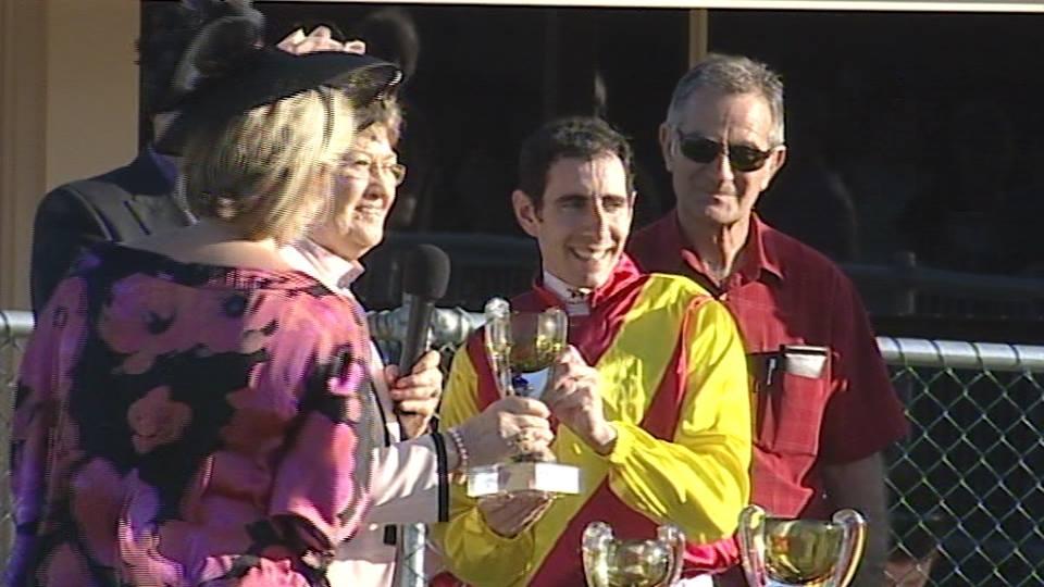 Lucas receiving his trophy