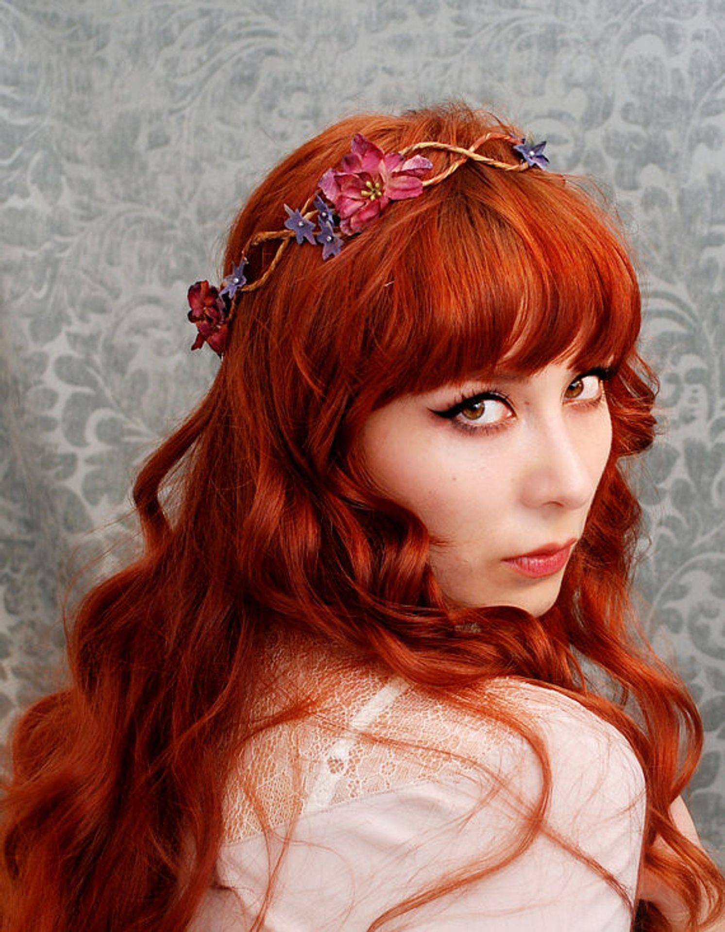 Flame red blond color. Long hair with a fringe