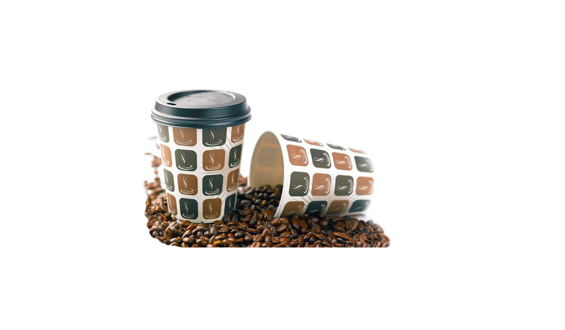 Patterned paper coffee cups resting on full-bean coffee beans