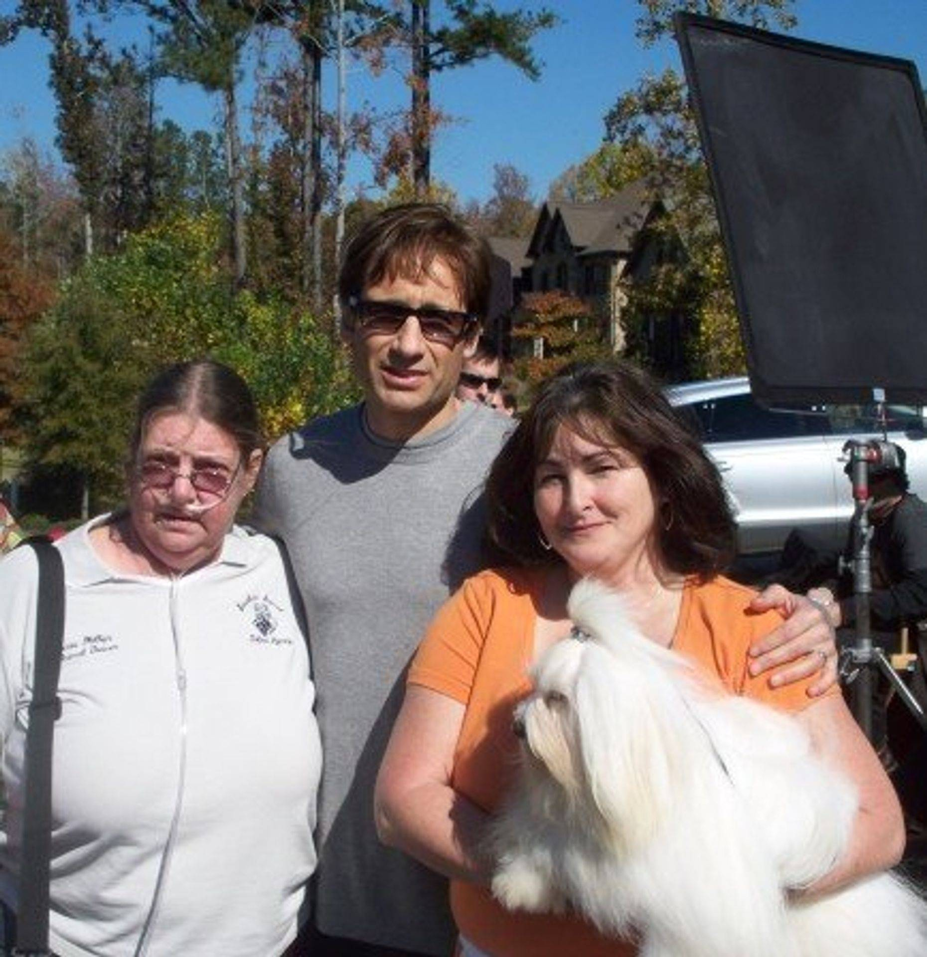 Coton de tulear Apollo on set of The Jones Atlanta Ga with David Duchovny