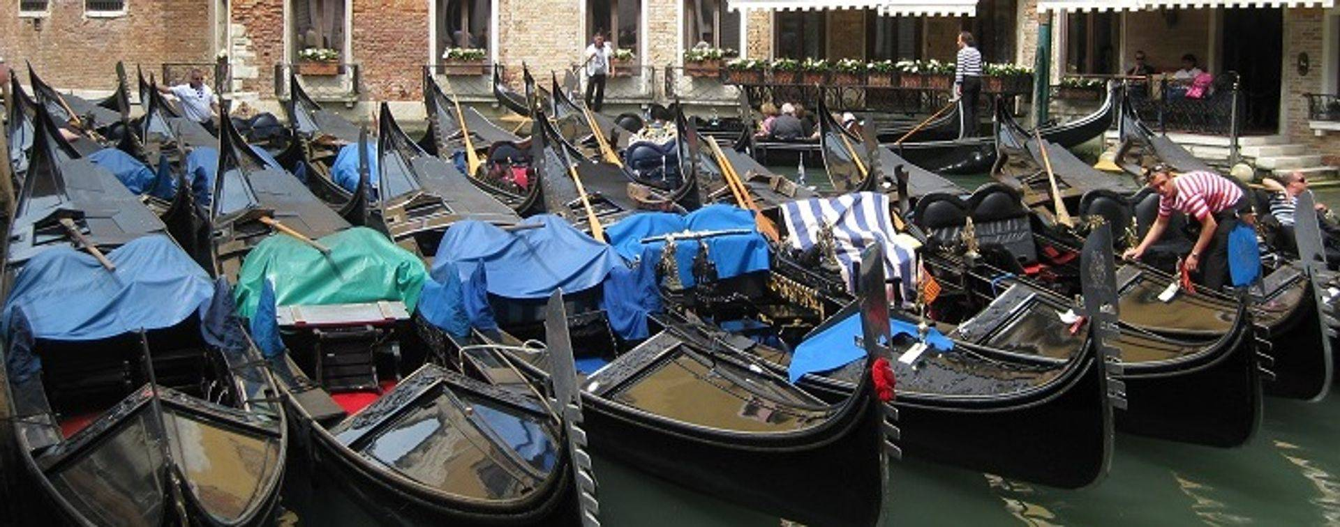 "womens travel.jpg alt= womens travel, gondolas in a row, venice, italy "">"