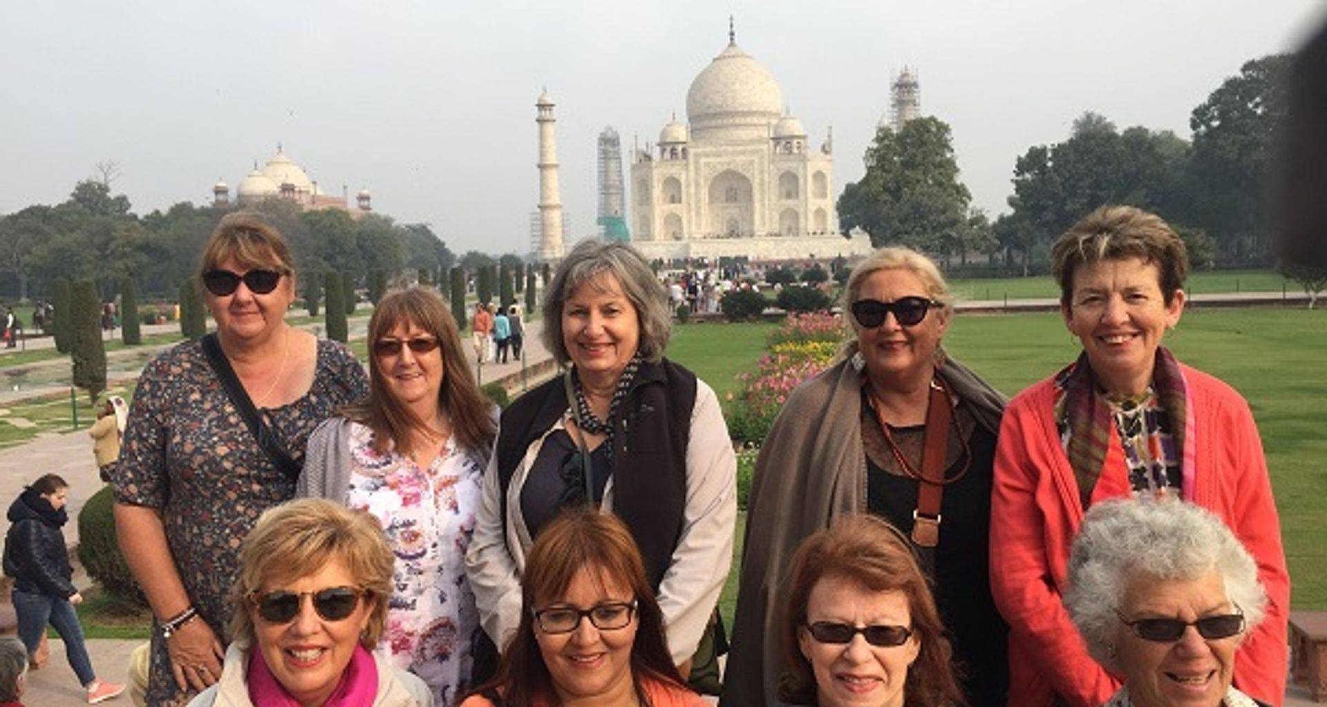 "<img src=""australian womens travel.jpg alt=womens tours, tour group sitting on bench in front of the taj mahal, agra, india"">"