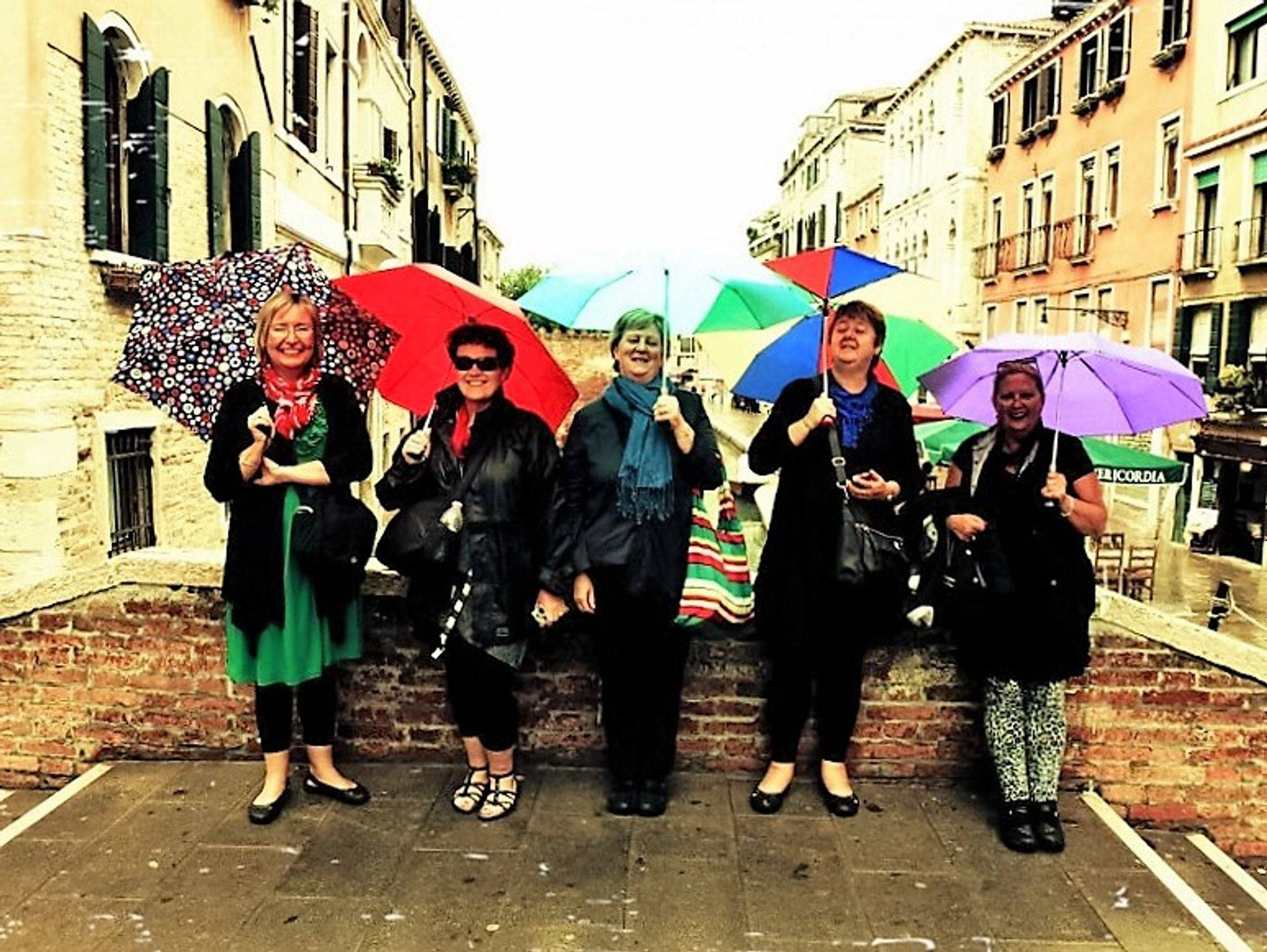 "<img src=""australian womens travel.jpg alt=womens tour group with umbrellas venice italy"">"