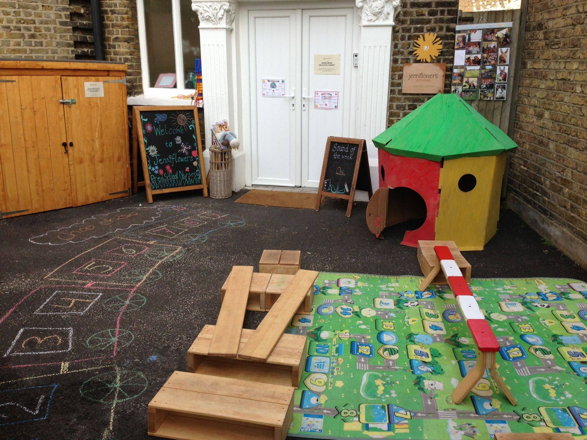 We love the wonder of cardboard, large wooden blocks and beams for balancing, and outdoor chalking