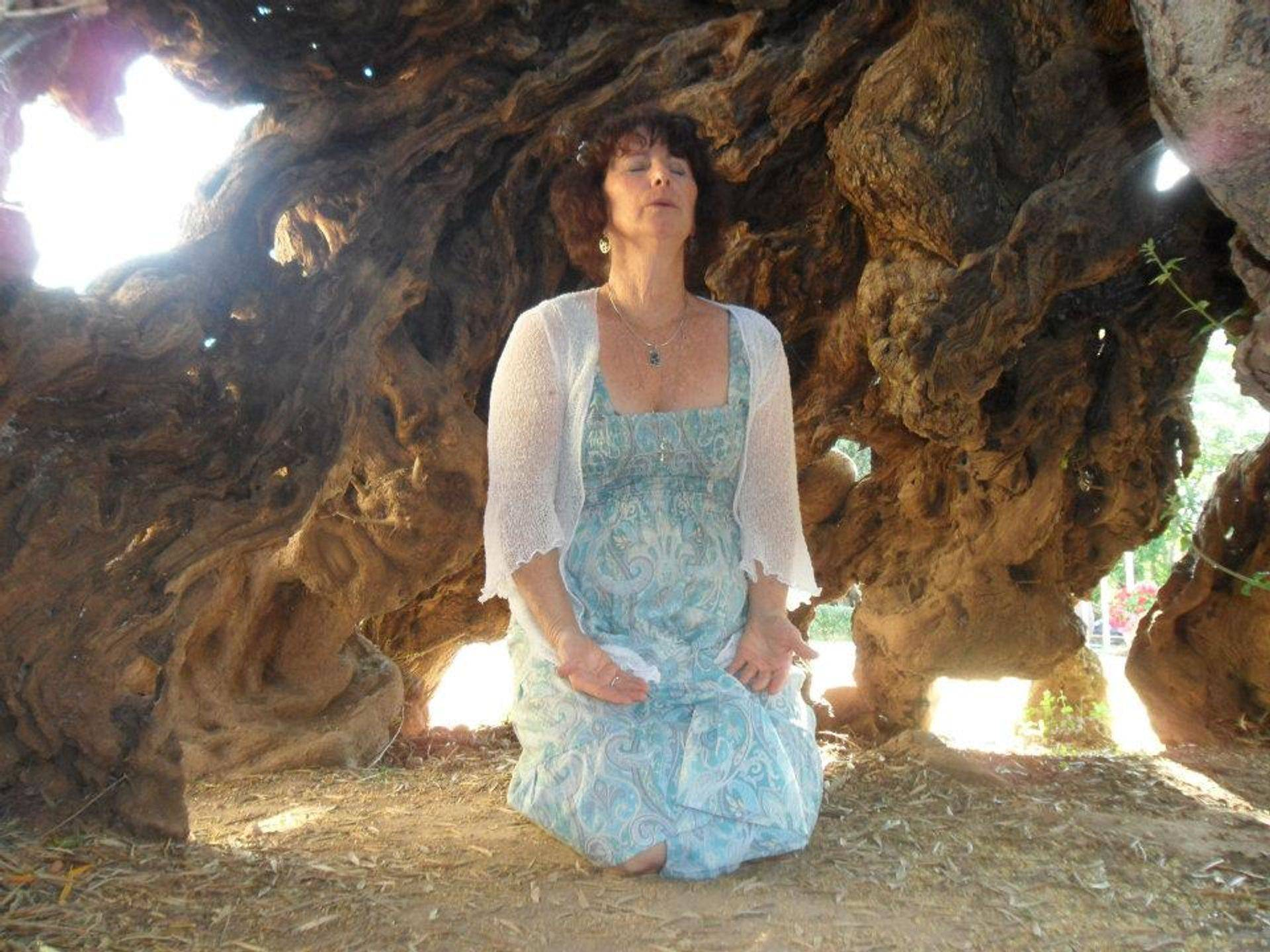 ChristinA of LUXOR Light Ascension channeling Sacred Sound inside the World's Oldest Olive Tree in Crete