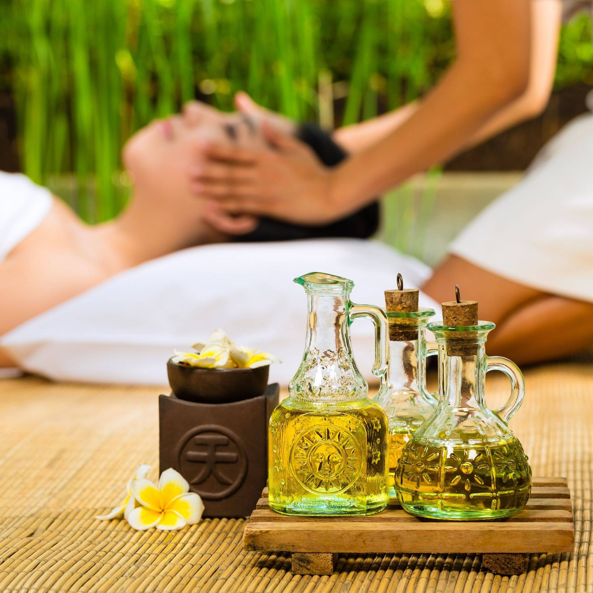 Oils for massage with a tranquil theme