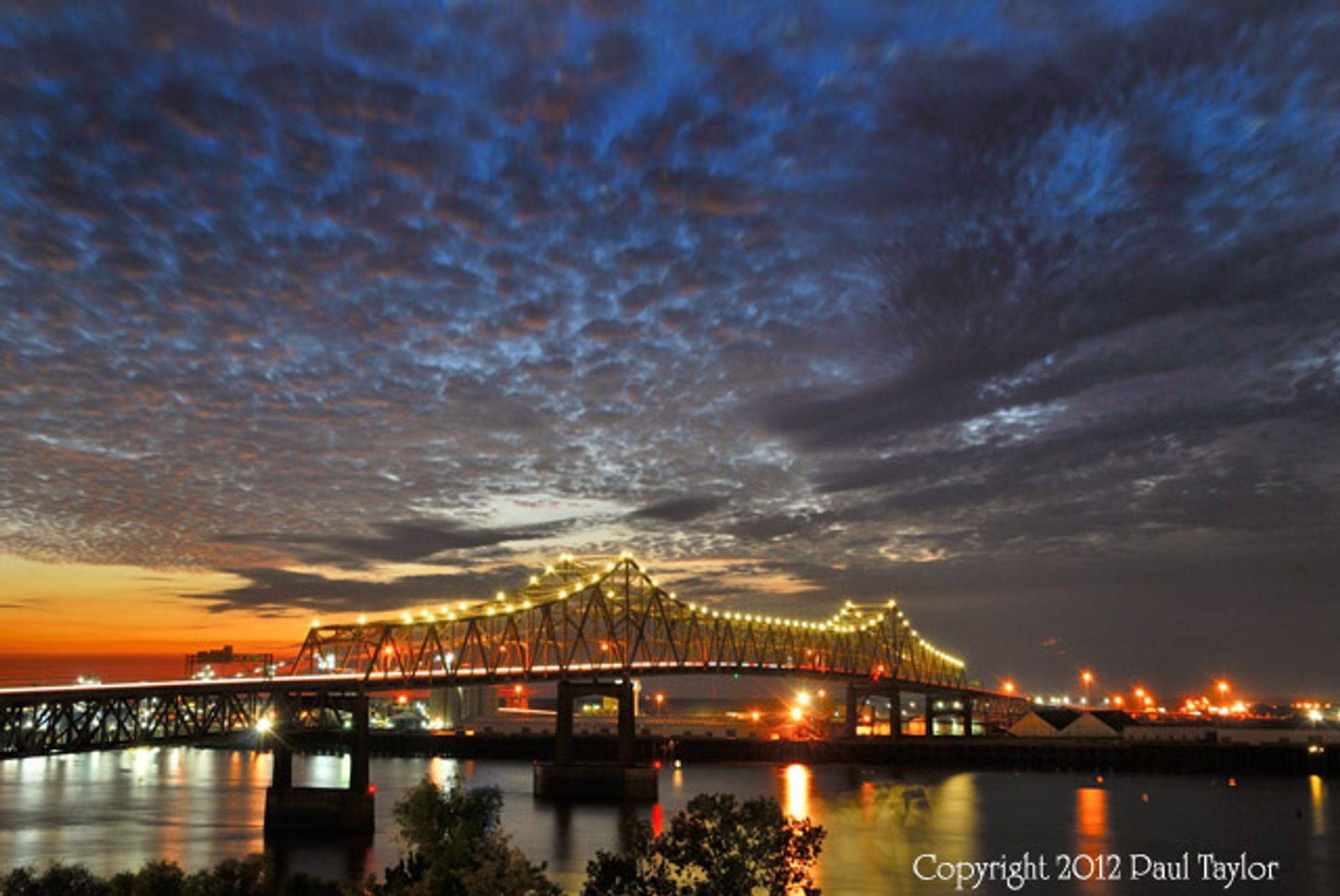 Horace Wilkinson Bridge over the Mississippi River, dusk with clouds