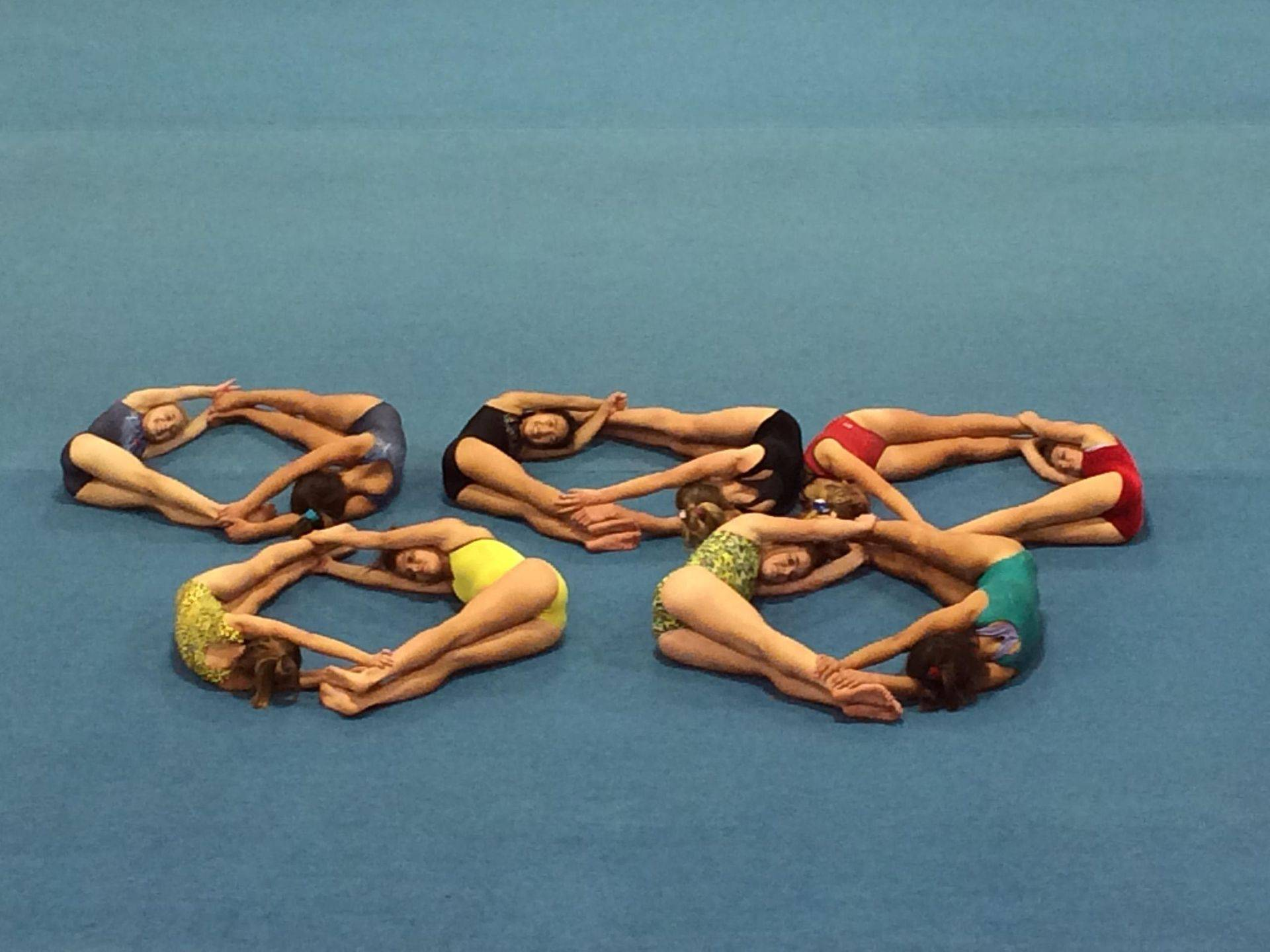 Athletes form Olympic Rings