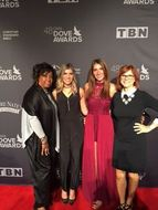 Executive Producer and Show Hosts at the Dove Awards image
