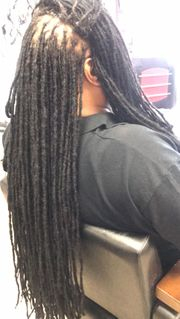 Braids by Bee reinforces thin roots of natural dreadlocks to keep them from popping out or breaking off.